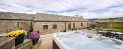 Sunrise Barn enclosed private rear garden with luxury hot tub